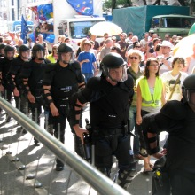 Riot cops protecting participants (2008).