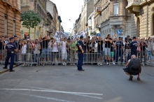 Demonstrators at police cordon on Andrássy Avenue side street.