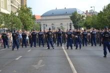 Demonstrators at police cordon at Deák Square.