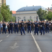 Demonstrators at police cordon at Deák Square.