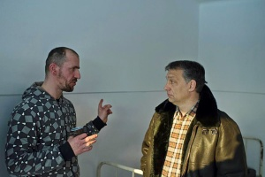 Prime Minister Viktor Orbán chats with resident during visit to homeless shelter in Budapest in February 2012.