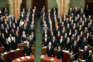 Fidesz National Assembly representatives stand for the National Anthem following adoption of the Fundamental Law.