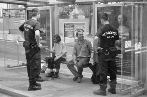 Police conduct identity check on homeless men in the 11th district of Budapest.