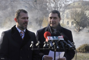 Prime Minister's Office officials Giró-Szász (left) and Lázár announce first round of public utility-fee cuts.