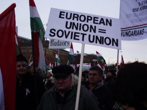 Participant carries anti-European Union sign during Peace March.
