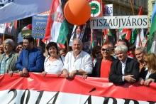 Peace March organizer András Bencsik (center).