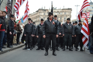 New Hungarian Guard István Mészáros stands at the head of a column of uniformed members at the Jobbik March 15 assembly in 2014.