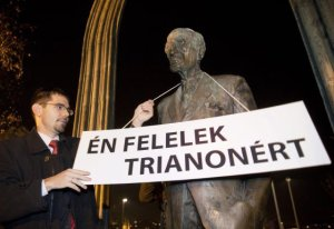 "Jobbik Vice-President Előd Novák places sign on statue of Mihály Károlyi: ""I Am Responsible for Trianon."""