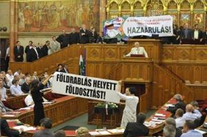 Jobbik and Politics Can Be Different representatives protest the new Land Law.