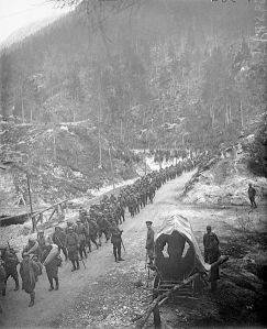 Italian troops advance through a mountain pass during the Battle of Vittorio Veneto.