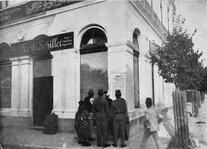 Sarajevans read notification of Austria-Hungary's annexation of Bosnia and Herzegovina posted at Moritz Schiller's delicatessen. Gavrilo Princip would assassinate Archduke Franz Ferdinand from this location six years later.