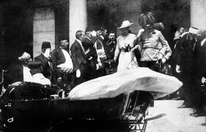 Duchess Sophie and Archduke Franz Ferdinand enter a motor vehicle in Sarajevo shortly before their assassination.