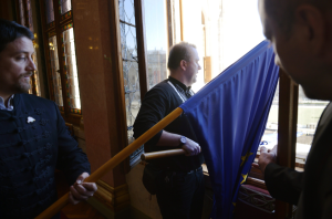 Jobbik representative Tamás Nagy-Gaudi prepares to throw a European Union flag out the window of the Hungarian Parliament Building.