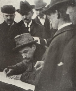 President Károlyi signs documents redistributing his estate in north-central Hungary.