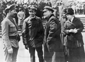 Tibor Szamuely (second from left) and Vladimir Lenin chat in Moscow in May 1919.