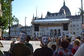 Demonstrators with Guy Fawkes masks.
