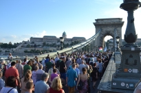 Demonstrators march across the Chain Bridge.