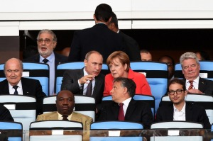 Prime Minister Orbán (looking back) sits next to his son Gáspár at the 2014 FIFA World Cup final.