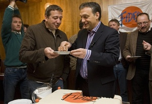 Zsolt Bayer (left) receives a piece of cake from Viktor Orbán at Fidesz's 21st birthday celebration in 2009.