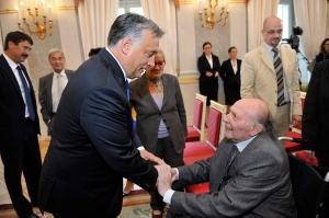 Nobel Prize-winning author Imre Kertész receives congratulations from Prime Minister Viktor Orbán before receiving his