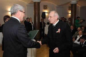 Fidesz Rural Development Minister Sándor Fazekas presents Péter Szentmihályi Szabó with a Hungarian Order of Merit state award for his literary and journalistic achievement on March 14, 2013.