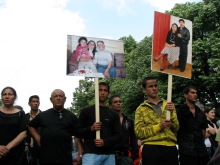 Signs bearing photo of Gypsy man killed in racial assassination (9/20/2008).
