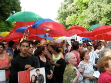 """Fanning umbrellas against """"brown (fascist) rain."""" Protest against the racial assassination of Gypsies (9/20/2008)."""
