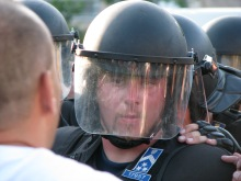 Riot cop face to face with protester at demonstration in support of newly banned Hungarian Guard (7/4/2009).