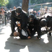 Riot cops tackle anti-gay demonstrator at the Budapest Pride parade (7/5/2008).