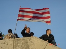 Anti-government demonstrators with Árpád-striped flag (5/9/2007).