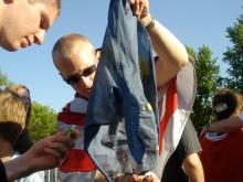 Burning a European Union flag during Romantic Violence concert at Jobbik May Day celebration (4/30/2007).