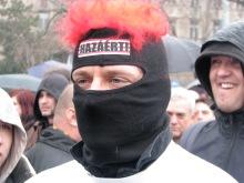 """György Budaházy in """"For the Homeland!"""" mask during protest at Budapest Mayor Gábor Demszky's annual March 15 speech (3/15/2008)."""