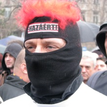 "György Budaházy in ""For the Homeland!"" mask during protest at Budapest Mayor Gábor Demszky's annual March 15 speech (3/15/2008)."