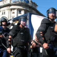 Riot cops protect participants in Budapest Pride parade from anti-gay demonstrators (7/72007).