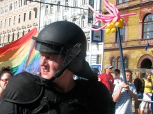 Riot cop protects participants in Budapest Pride parade from anti-gay demonstrators (7/7/2007).