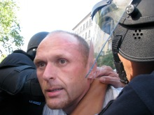 Cops arrest anti-gay demonstrator at annual Budapest Pride parade (7/7/2007).
