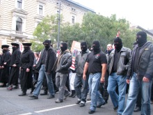 Masked demonstrators march down Andrássy Avenue on way to protest at Soviet War Memorial (9/20/2008).