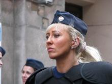 Female riot cop monitors Tomcat-organized ticket-office demonstration (4/11/ 2008).