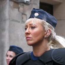 Female riot cop monitors Tomcat-organized ticket-office demonstration (4/11/ 2008).