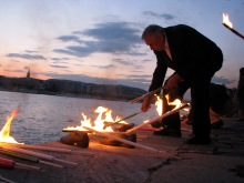 Man lights torch at Shoes on the Danube Bank Hungarian Holocaust Memorial (5/9/2008),