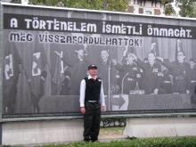 Hungarian Guard member poses before anti-fascist sign (9/21/2007).