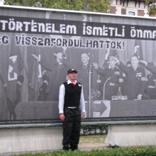 Hungarian Guard member poses before anti-fascist sign (9/21/2007).