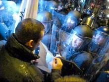 László Toroczkai shows riot caps demonstration permit near Budapest Opera House (10/22/2007).