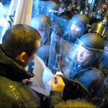 László Toroczkai shows riot caps demonstration permit near Budapest Opera House (10/22/2007).