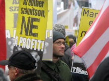 """Trade union demonstrator holding sign proclaiming """"Let People Count, Not Profit!"""" (12/15/2007)"""