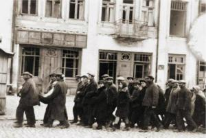 Jews deported from Hungary marching to their deaths outside