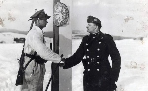 Soldiers from Poland and Hungary shake hands at the new common border in 1939.