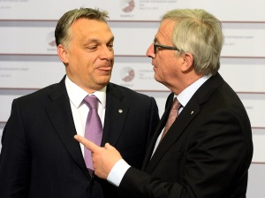 Hungarian Prime Minister Viktor Orban is greeted by President of the European Commission Jean-Claude Juncker on the second day of the fourth European Union (EU) eastern Partnership Summit in Riga, on May 22, 2015 as Latvia holds the rotating presidency of the EU Council. EU leaders and their counterparts from Ukraine and five ex-Soviet states hold a summit focused on bolstering their ties, an initiative that has been undermined by Russia's intervention in Ukraine. AFP PHOTO / JANEK SKARZYNSKI