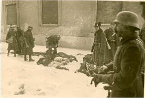 Hungarian Royal Army soldiers inspect corpses following massacre in Újvidék.