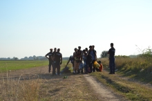 Hungarian police receive a group of refugees.